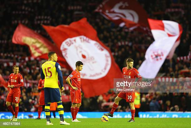 Adam Lallana of Liverpool prepares to kick off with Philippe Coutinho of Liverpool during the Barclays Premier League match between Liverpool and...