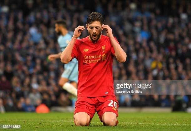 Adam Lallana of Liverpool reacts after missing a chance to score during the Premier League match between Manchester City and Liverpool at Etihad...
