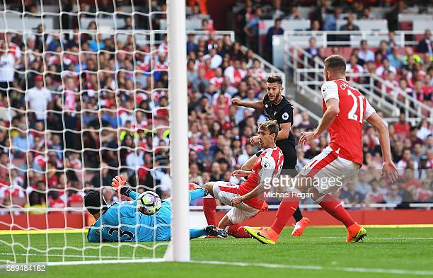 Adam Lallana of Liverpool scores his team's second goal during the Premier League match between Arsenal and Liverpool at Emirates Stadium on August...