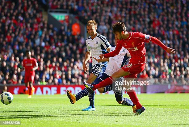 Adam Lallana of Liverpool scores the opening goal during the Barclays Premier League match between Liverpool and West Bromwich Albion at Anfield on...