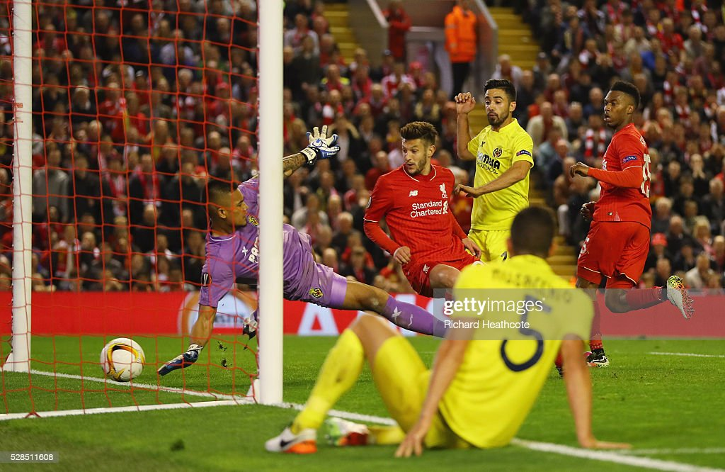 Adam Lallana of Liverpool (C) scores their third goal past goalkeeper Alphonse Areola of Villarreal during the UEFA Europa League semi final second leg match between Liverpool and Villarreal CF at Anfield on May 5, 2016 in Liverpool, England.