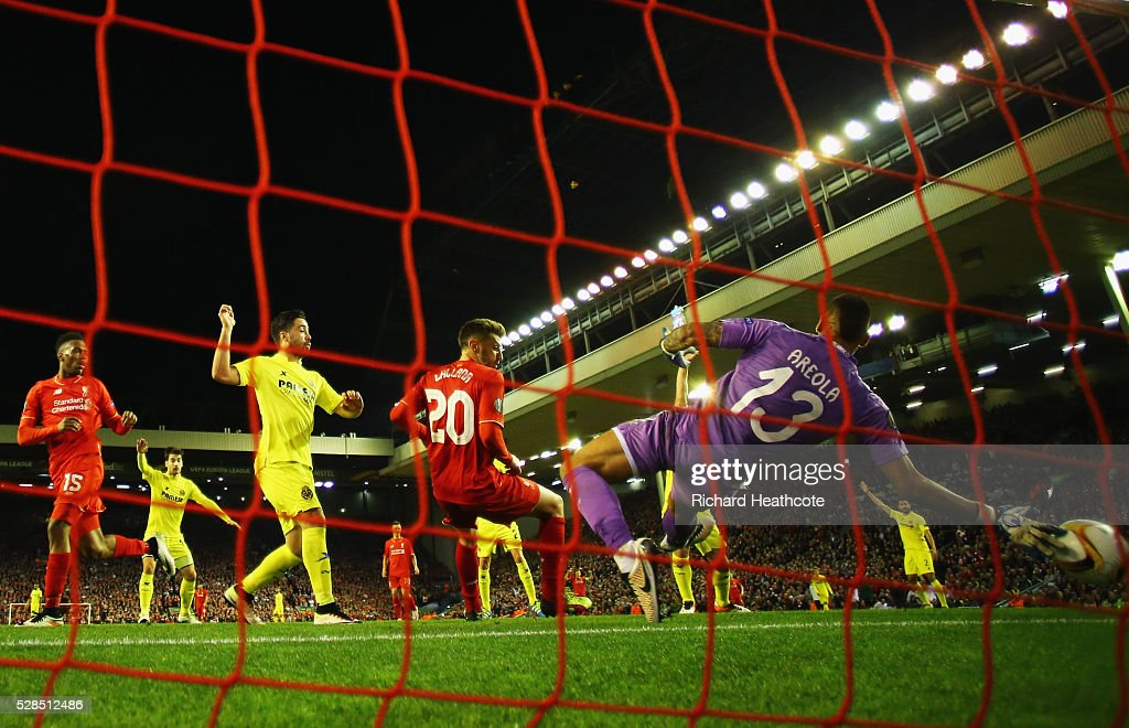 Adam Lallana of Liverpool (20) scores their third goal past goalkeeper Alphonse Areola of Villarreal during the UEFA Europa League semi final second leg match between Liverpool and Villarreal CF at Anfield on May 5, 2016 in Liverpool, England.