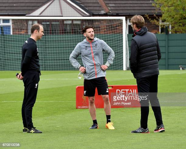 Adam Lallana of Liverpool seen with manager Jurgen Klopp during a training session at Melwood Training Ground on April 19 2017 in Liverpool England