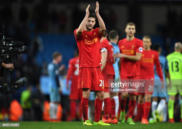Adam Lallana of Liverpool shows appreciation to the fans after the Premier League match between Manchester City and Liverpool at Etihad Stadium on...