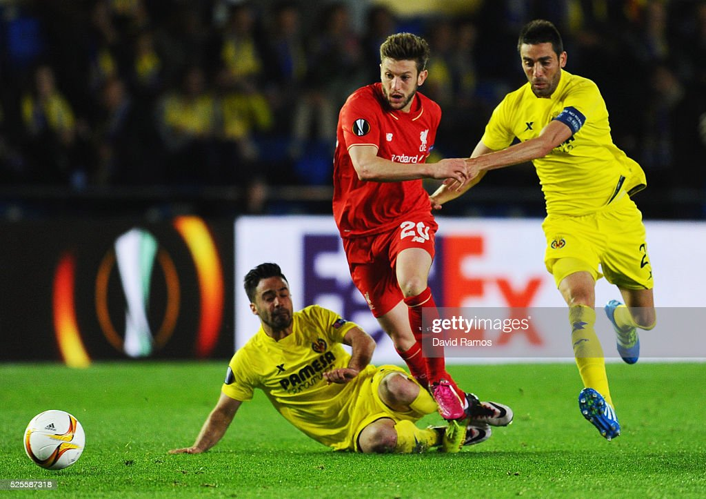 <a gi-track='captionPersonalityLinkClicked' href=/galleries/search?phrase=Adam+Lallana&family=editorial&specificpeople=5475862 ng-click='$event.stopPropagation()'>Adam Lallana</a> of Liverpool takes on Jaume (L) and Bruno of Villarreal (R) during the UEFA Europa League semi final first leg match between Villarreal CF and Liverpool at Estadio El Madrigal on April 28, 2016 in Villarreal, Spain.