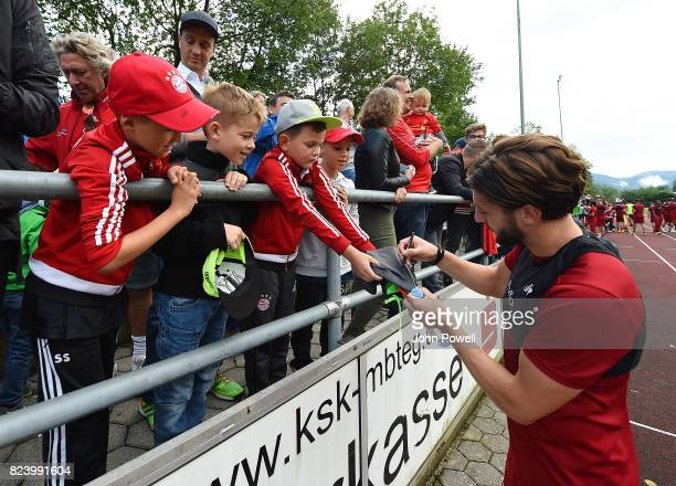 Adam Lallana of Liverpool with fans at the end of the training session at RottachEgern on July 28 2017 in Munich Germany