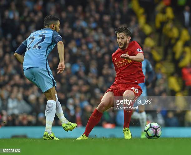 Adam Lallana of Liverpool with Gael Clichy of Man City during the Premier League match between Manchester City and Liverpool at Etihad Stadium on...