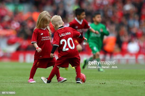 Adam Lallana of Liverpool's children playing on the pitch during the Premier League match between Liverpool and Middlesbrough at Anfield on May 21...