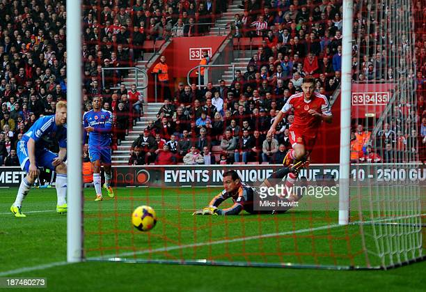Adam Lallana of Southampton beats Steve Harper of Hull City to score their third goal during the Barclays Premier League match between Southampton...