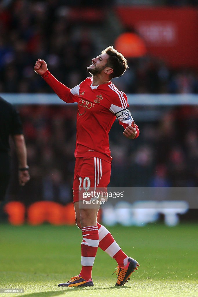 <a gi-track='captionPersonalityLinkClicked' href=/galleries/search?phrase=Adam+Lallana&family=editorial&specificpeople=5475862 ng-click='$event.stopPropagation()'>Adam Lallana</a> of Southampton celebrates after scoring the opening goal during the Barclays Premier League match between Southampton and Tottenham Hotspur at St Mary's Stadium on December 22, 2013 in Southampton, England.
