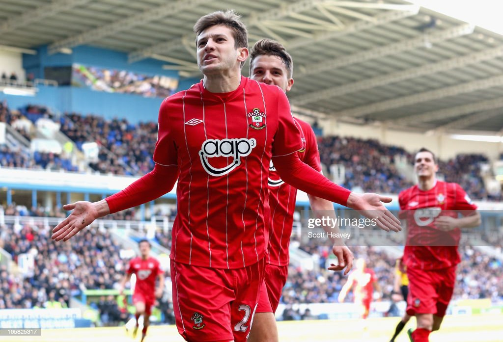 <a gi-track='captionPersonalityLinkClicked' href=/galleries/search?phrase=Adam+Lallana&family=editorial&specificpeople=5475862 ng-click='$event.stopPropagation()'>Adam Lallana</a> of Southampton celebrates scoring his side's second goal during the Barclays Premier League match between Reading and Southampton at the Madejski Stadium on April 6, 2013 in Reading, England.