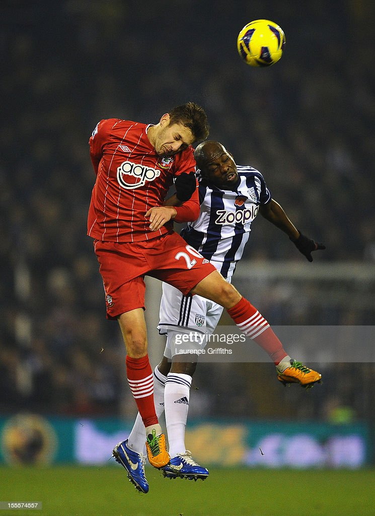 <a gi-track='captionPersonalityLinkClicked' href=/galleries/search?phrase=Adam+Lallana&family=editorial&specificpeople=5475862 ng-click='$event.stopPropagation()'>Adam Lallana</a> of Southampton goes up for a header with <a gi-track='captionPersonalityLinkClicked' href=/galleries/search?phrase=Youssuf+Mulumbu&family=editorial&specificpeople=4044093 ng-click='$event.stopPropagation()'>Youssuf Mulumbu</a> of West Bromwich Albion during the Barclays Premier League match between West Bromwich Albion and Southampton at The Hawthorns on November 5, 2012 in West Bromwich, England.
