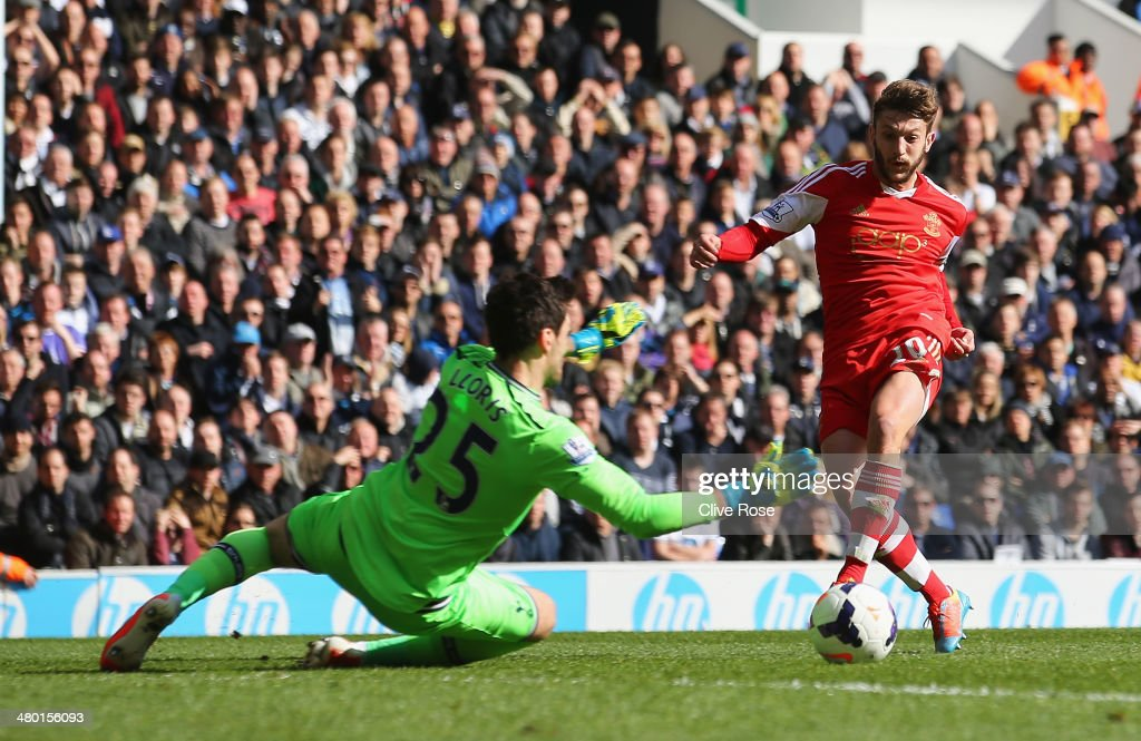 <a gi-track='captionPersonalityLinkClicked' href=/galleries/search?phrase=Adam+Lallana&family=editorial&specificpeople=5475862 ng-click='$event.stopPropagation()'>Adam Lallana</a> of Southampton scores his team's second goal past <a gi-track='captionPersonalityLinkClicked' href=/galleries/search?phrase=Hugo+Lloris&family=editorial&specificpeople=2501893 ng-click='$event.stopPropagation()'>Hugo Lloris</a> of Tottenham Hotspur during the Barclays Premier League match between Tottenham Hotspur and Southampton at White Hart Lane on March 23, 2014 in London, England.