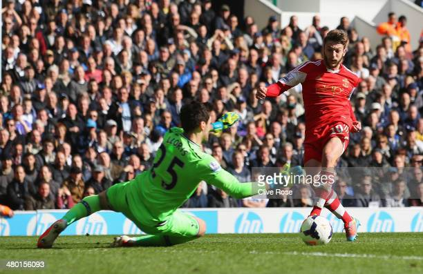 Adam Lallana of Southampton scores his team's second goal past Hugo Lloris of Tottenham Hotspur during the Barclays Premier League match between...