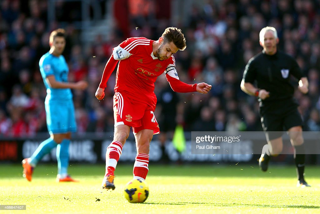 <a gi-track='captionPersonalityLinkClicked' href=/galleries/search?phrase=Adam+Lallana&family=editorial&specificpeople=5475862 ng-click='$event.stopPropagation()'>Adam Lallana</a> of Southampton scores the opening goal during the Barclays Premier League match between Southampton and Tottenham Hotspur at St Mary's Stadium on December 22, 2013 in Southampton, England.