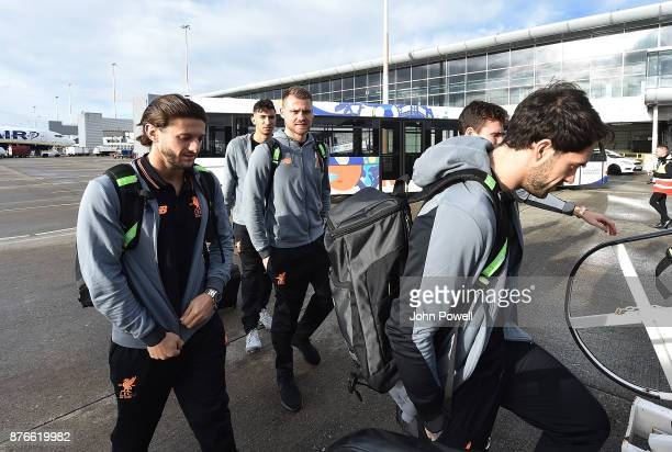 Adam Lallana Simon Mignolet and Danny Ings of Liverpool before departing for the group E Champions League match between Sevilla and Liverpool at...