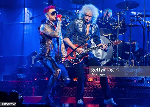 Adam Lambert and Brian May of Queen perform at The Palace of Auburn Hills on July 20 2017 in Auburn Hills Michigan