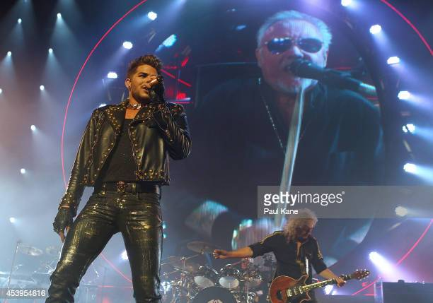 Adam Lambert and Brian May perform on stage during the QUEEN and Adam Lambert Tour at Perth Arena on August 22 2014 in Perth Australia This is the...