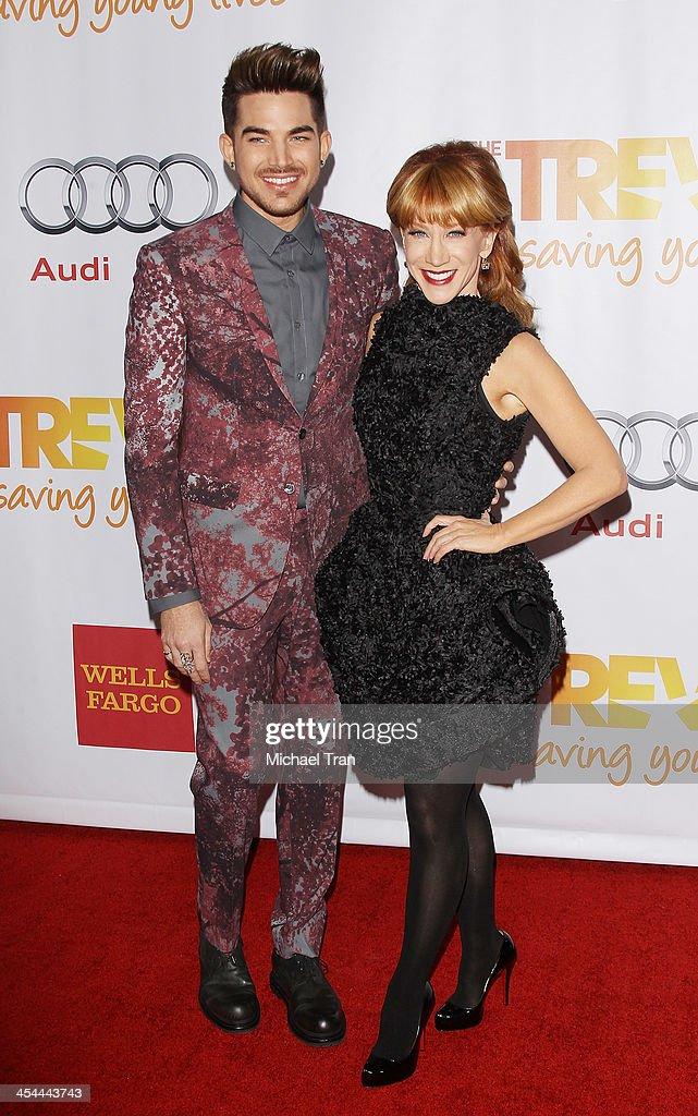 Adam Lambert (L) and Kathy Griffin arrive at the 15th Annual Trevor Project Benefit held at Hollywood Palladium on December 8, 2013 in Hollywood, California.