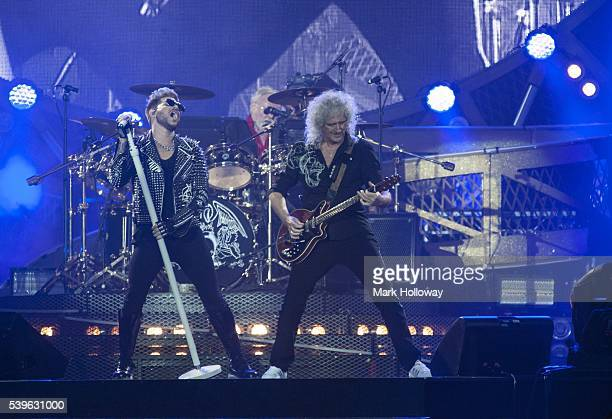Adam Lambert Brian May and Roger Taylor of Queen Adam Lambert perform on stage at Seaclose Park on June 12 2016 in Newport Isle of Wight