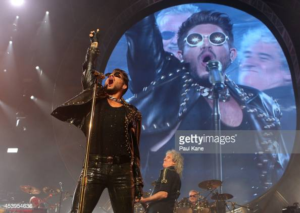 Adam Lambert Brian May and Roger Taylor perform on stage during the QUEEN and Adam Lambert Tour at Perth Arena on August 22 2014 in Perth Australia...