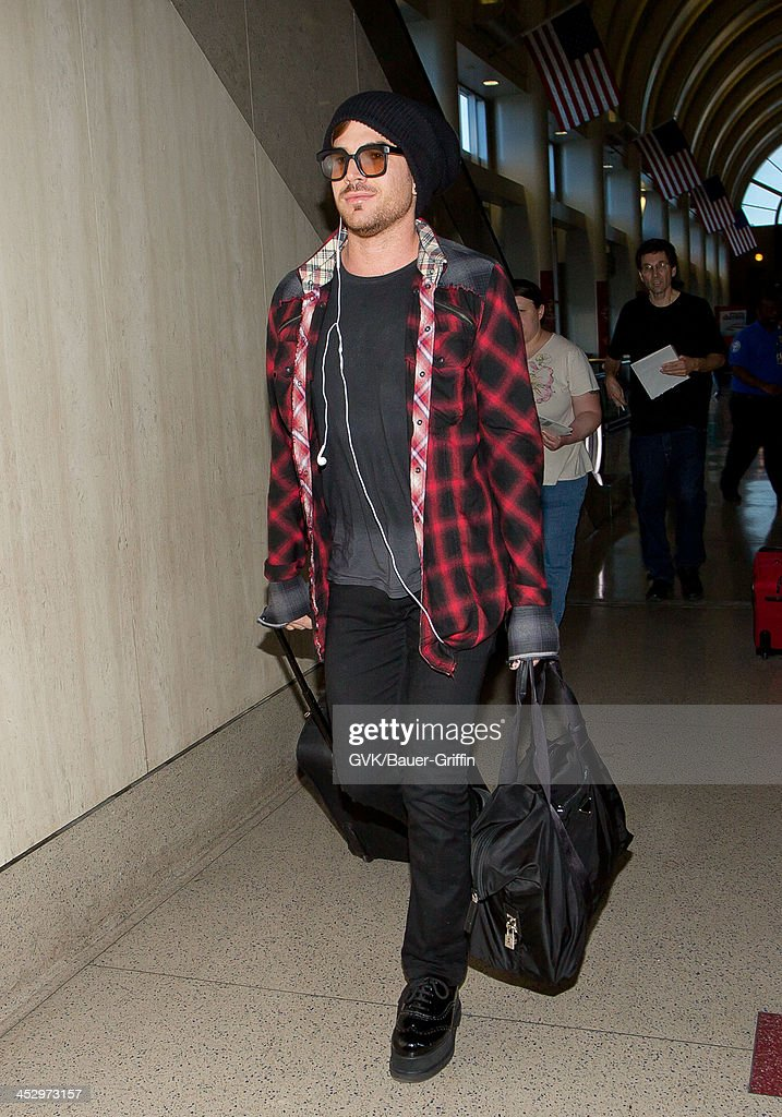 <a gi-track='captionPersonalityLinkClicked' href=/galleries/search?phrase=Adam+Lambert&family=editorial&specificpeople=5706674 ng-click='$event.stopPropagation()'>Adam Lambert</a> is seen arriving at LAX airport on December 01, 2013 in Los Angeles, California.