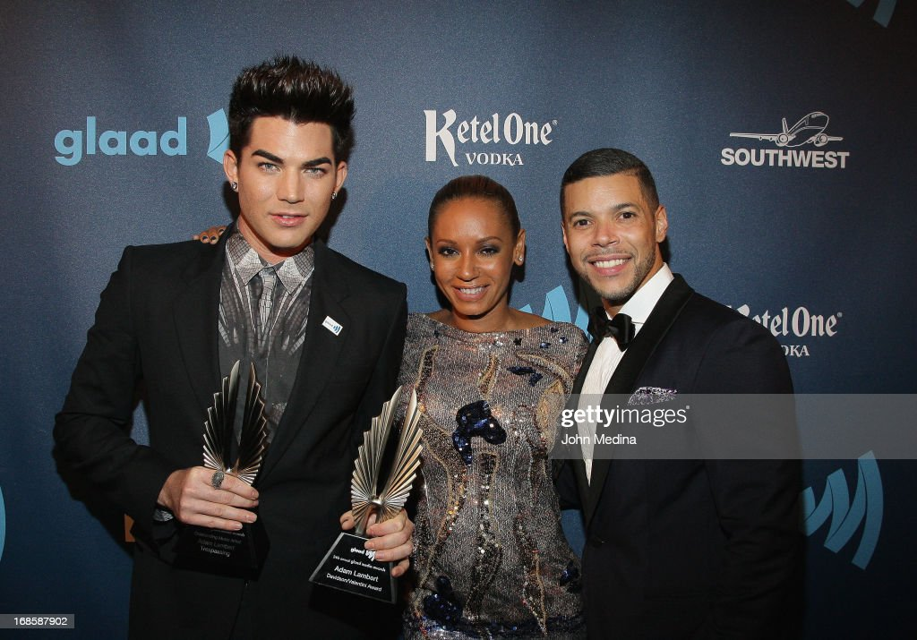 <a gi-track='captionPersonalityLinkClicked' href=/galleries/search?phrase=Adam+Lambert&family=editorial&specificpeople=5706674 ng-click='$event.stopPropagation()'>Adam Lambert</a>, Mel B aka <a gi-track='captionPersonalityLinkClicked' href=/galleries/search?phrase=Melanie+Brown&family=editorial&specificpeople=159736 ng-click='$event.stopPropagation()'>Melanie Brown</a> and <a gi-track='captionPersonalityLinkClicked' href=/galleries/search?phrase=Wilson+Cruz&family=editorial&specificpeople=660625 ng-click='$event.stopPropagation()'>Wilson Cruz</a> pose for a photo during the 24th Annual GLAAD Media Awards at the Hilton San Francisco - Union Square on May 11, 2013 in San Francisco, California. Lambert received the 2013 Davidson/Valentini Award