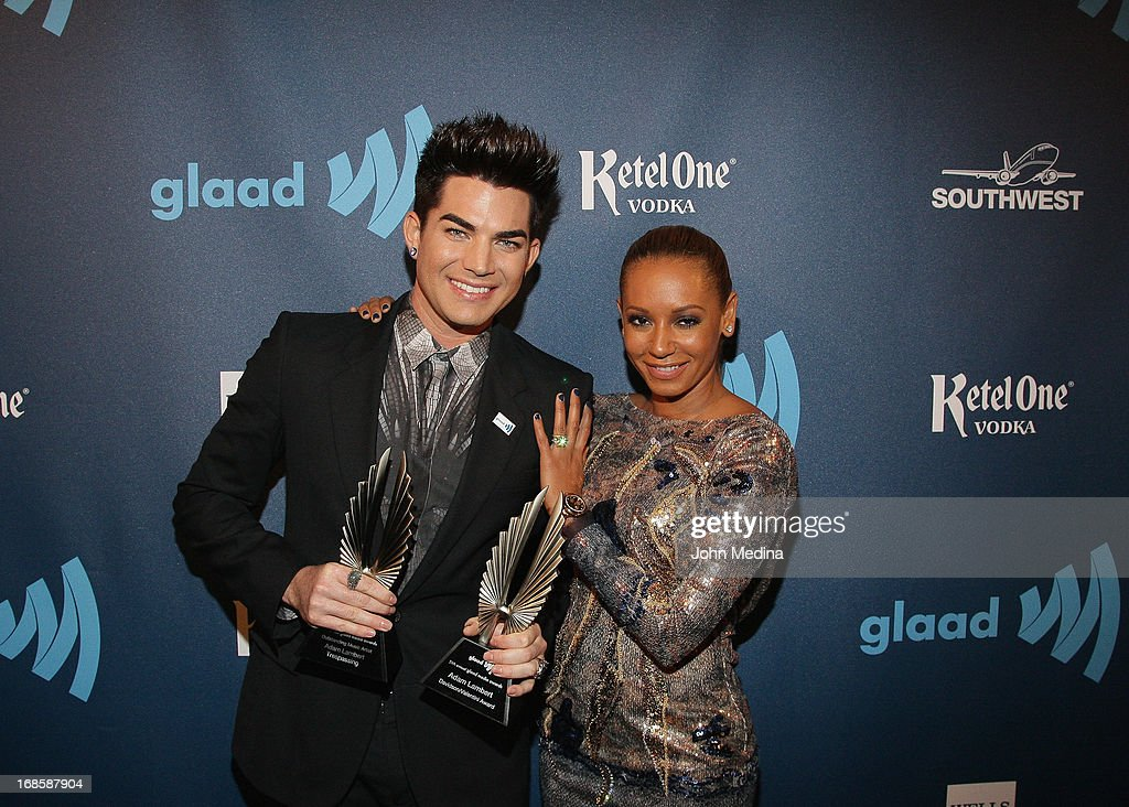 <a gi-track='captionPersonalityLinkClicked' href=/galleries/search?phrase=Adam+Lambert&family=editorial&specificpeople=5706674 ng-click='$event.stopPropagation()'>Adam Lambert</a>, Mel B aka <a gi-track='captionPersonalityLinkClicked' href=/galleries/search?phrase=Melanie+Brown&family=editorial&specificpeople=159736 ng-click='$event.stopPropagation()'>Melanie Brown</a> pose for a photo during the 24th Annual GLAAD Media Awards at the Hilton San Francisco - Union Square on May 11, 2013 in San Francisco, California. Lambert received the 2013 Davidson/Valentini Award