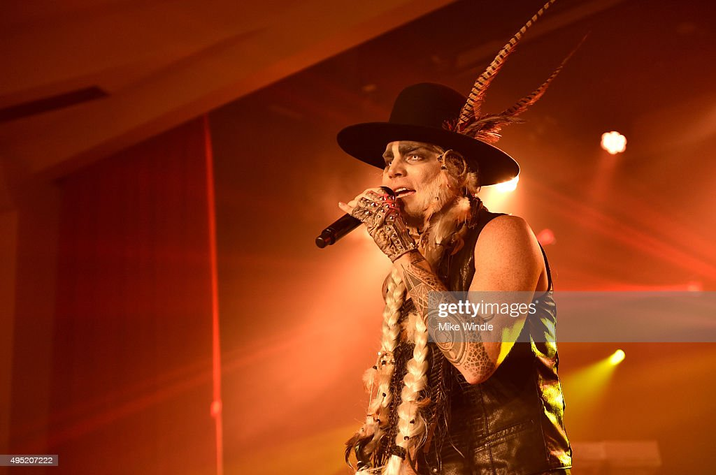 Adam Lambert performs onstage at his Ghost Town Halloween Party hosted by Hilton@PLAY at The Beverly Hilton on October 31, 2015 in Beverly Hills, California.