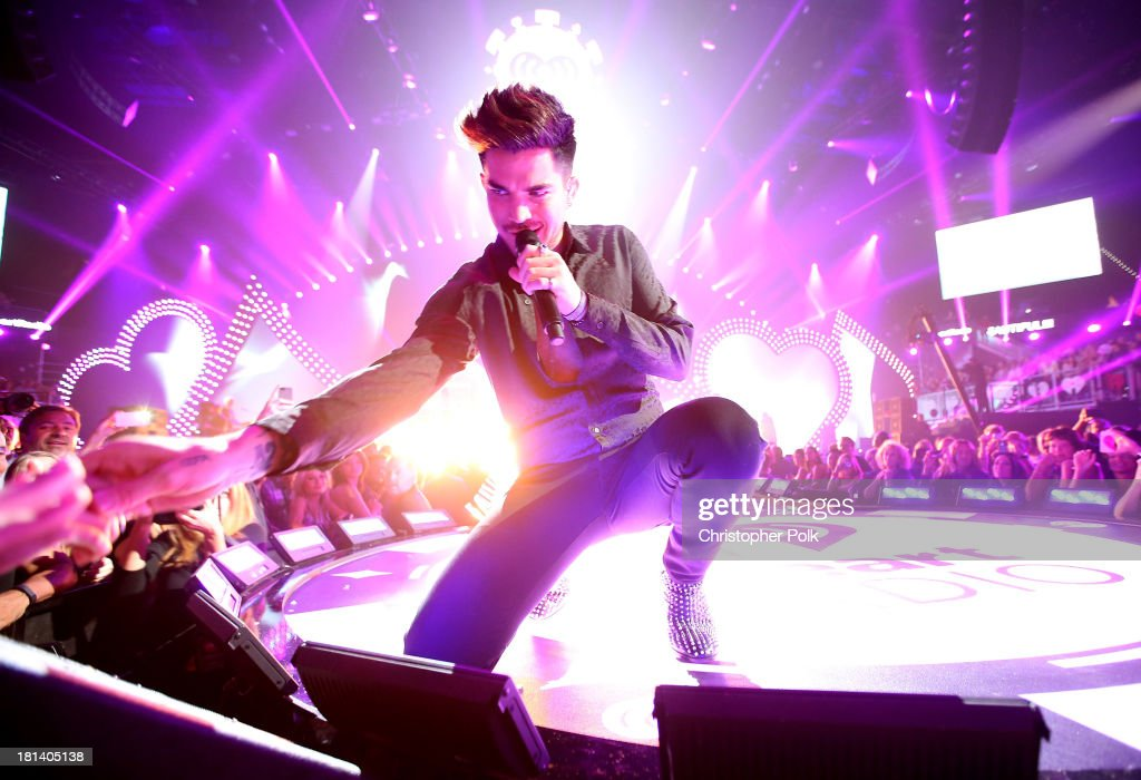 <a gi-track='captionPersonalityLinkClicked' href=/galleries/search?phrase=Adam+Lambert&family=editorial&specificpeople=5706674 ng-click='$event.stopPropagation()'>Adam Lambert</a> performs onstage with Queen during the iHeartRadio Music Festival at the MGM Grand Garden Arena on September 20, 2013 in Las Vegas, Nevada.