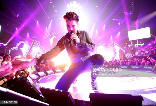 Adam Lambert performs onstage with Queen during the iHeartRadio Music Festival at the MGM Grand Garden Arena on September 20 2013 in Las Vegas Nevada