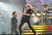 Adam Lambert performs with Brian May and Roger Taylor of Queen at 02 Arena on January 17 2015 in London England