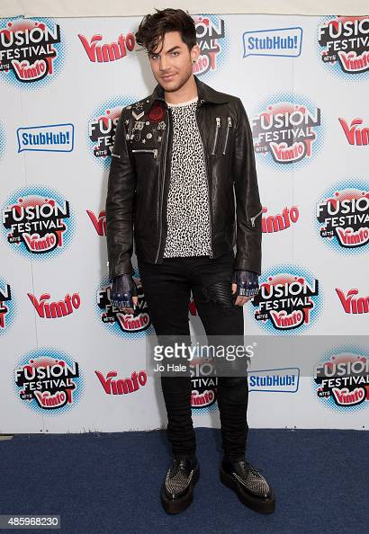 Adam Lambert poses in the Press Room at Fusion Festival at Cofton Park on August 30 2015 in Birmingham England