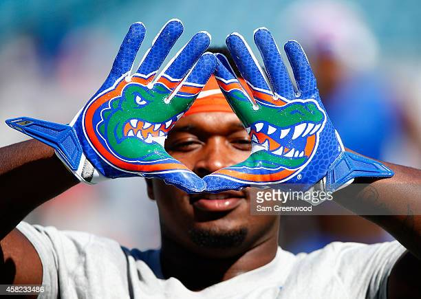 Adam Lane of the Florida Gators displays his gloves before the game against the Georgia Bulldogs at EverBank Field on November 1 2014 in Jacksonville...
