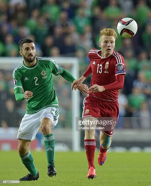 Adam Lang of Northern Ireland and Zsolt Kalmar of Hungary during the Euro 2016 Group F qualifying match at Windsor Park on September 7 2015 in...