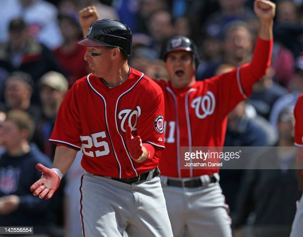 Adam LaRoche and Ryan Zimmerman of the Washington Nationals celebrate after LaRoche scores in the 8th inning against the Chicago Cubs at Wrigley...
