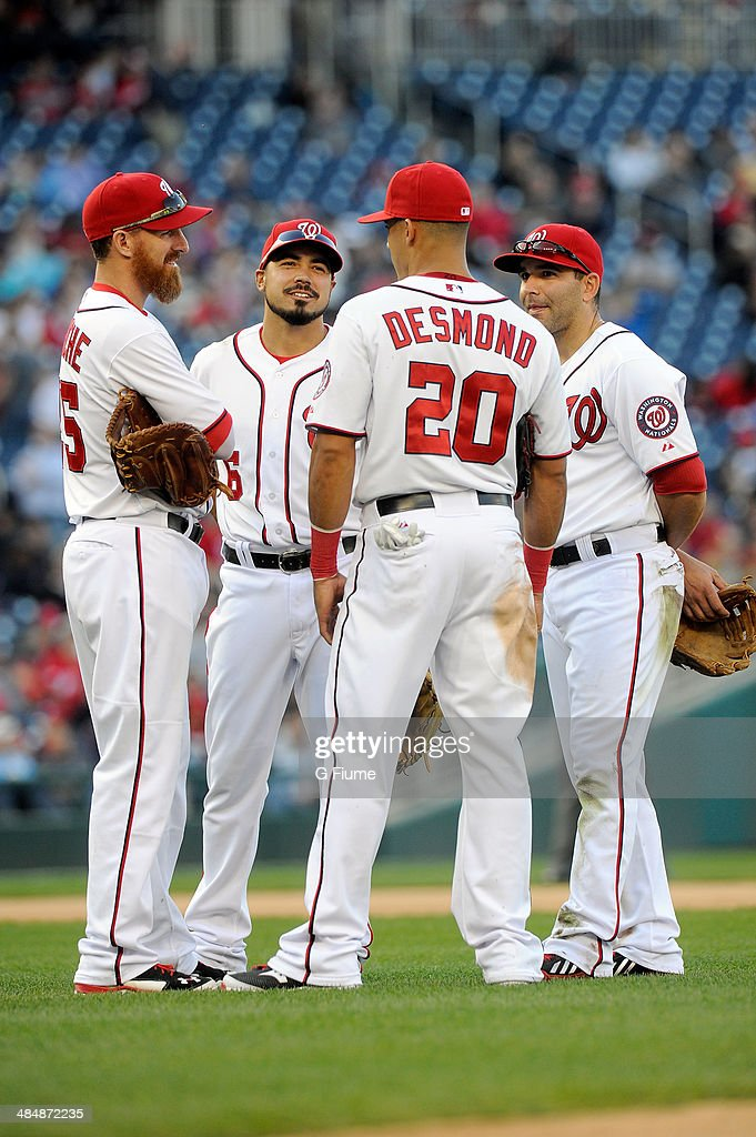 Adam LaRoche #25, Anthony Rendon #6, Ian Desmond #20 and Danny Espinosa #8 of the Washington Nationals talk during a pitching change in the game against the Miami Marlins at Nationals Park on April 10, 2014 in Washington, DC.