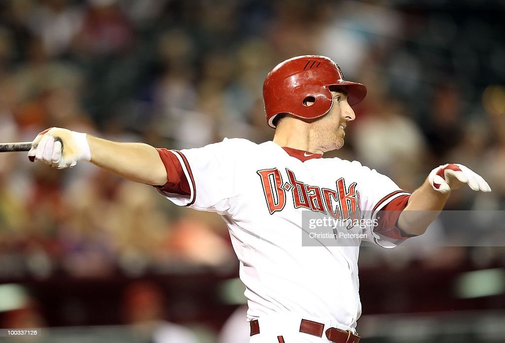 Adam LaRoche #25 of the Arizona Diamondbacks bats against the San Francisco Giants during the Major League Baseball game at Chase Field on May 20, 2010 in Phoenix, Arizona. The Diamondbacks defeated the Giants 8-7.