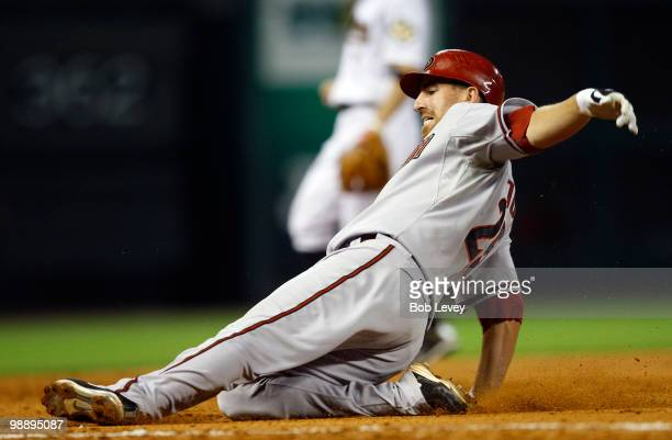 Adam LaRoche of the Arizona Diamondbacks slides safely into third base after hitting a triple in the fifth inning against the Houston Astros as third...