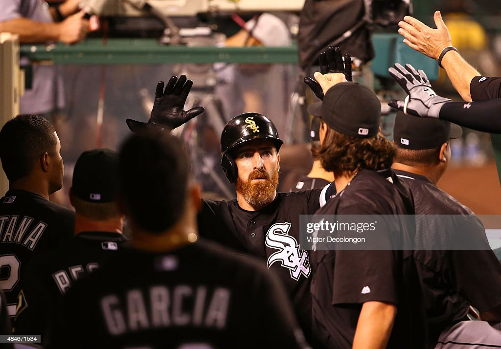<a gi-track='captionPersonalityLinkClicked' href=/galleries/search?phrase=Adam+LaRoche&family=editorial&specificpeople=216533 ng-click='$event.stopPropagation()'>Adam LaRoche</a> #25 of the Chicago White Sox celebrates with teammates in the dugout after scoring in the fifth inning during the MLB game against the Los Angeles Angels of Anaheim at Angel Stadium of Anaheim on August 20, 2015 in Anaheim, California.
