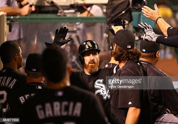 Adam LaRoche of the Chicago White Sox celebrates with teammates in the dugout after scoring in the fifth inning during the MLB game against the Los...