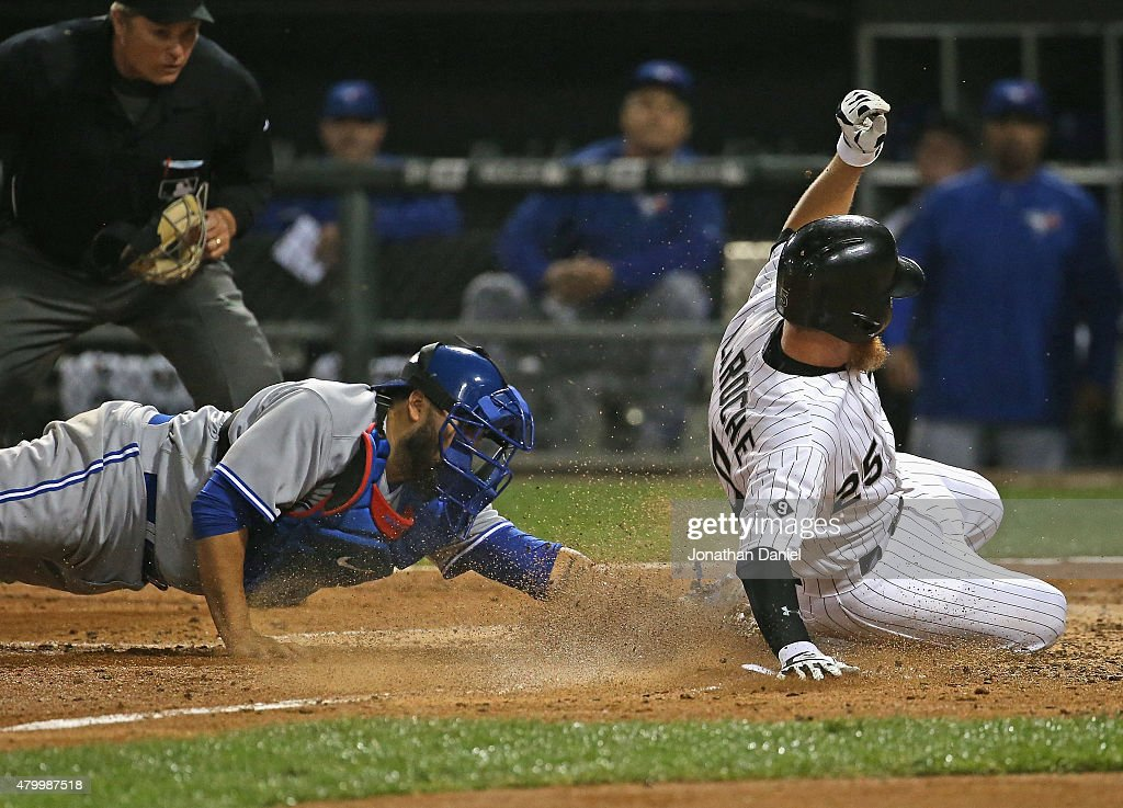 Adam LaRoche #25 of the Chicago White Sox scores a run in the 6th inning as <a gi-track='captionPersonalityLinkClicked' href=/galleries/search?phrase=Dioner+Navarro&family=editorial&specificpeople=593062 ng-click='$event.stopPropagation()'>Dioner Navarro</a> #30 of the Toronto Blue Jays attempts the tag at U.S. Cellular Field on July 8, 2015 in Chicago, Illinois.