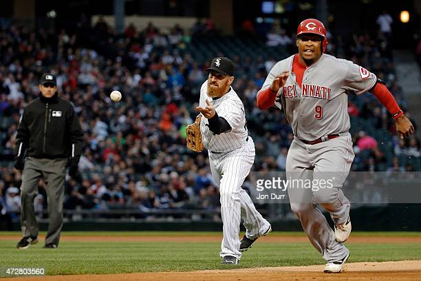 Adam LaRoche of the Chicago White Sox throws the ball to Emilio Bonifacio to force out Marlon Byrd of the Cincinnati Reds during the first inning in...