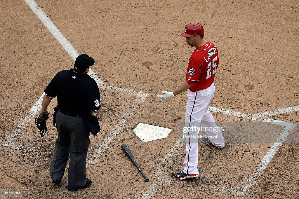 <a gi-track='captionPersonalityLinkClicked' href=/galleries/search?phrase=Adam+LaRoche&family=editorial&specificpeople=216533 ng-click='$event.stopPropagation()'>Adam LaRoche</a> #25 of the Washington Nationals argues with home plate umpire Sam Holbrook after striking out to end the fourth inning during a game against the Cincinnati Reds at Nationals Park on April 28, 2013 in Washington, DC.
