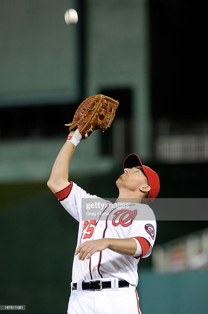 <a gi-track='captionPersonalityLinkClicked' href=/galleries/search?phrase=Adam+LaRoche&family=editorial&specificpeople=216533 ng-click='$event.stopPropagation()'>Adam LaRoche</a> #25 of the Washington Nationals catches a pop fly in the seventh inning against the Cincinnati Reds at Nationals Park on April 25, 2013 in Washington, DC.