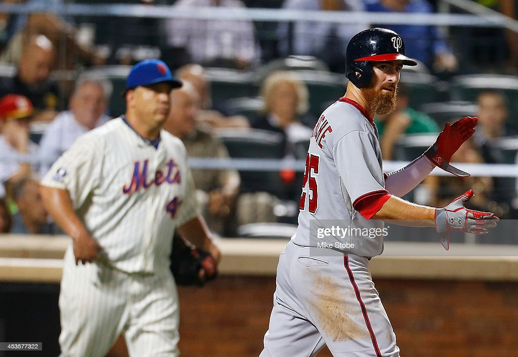 <a gi-track='captionPersonalityLinkClicked' href=/galleries/search?phrase=Adam+LaRoche&family=editorial&specificpeople=216533 ng-click='$event.stopPropagation()'>Adam LaRoche</a> #25 of the Washington Nationals celebrates after scoring on <a gi-track='captionPersonalityLinkClicked' href=/galleries/search?phrase=Bryce+Harper&family=editorial&specificpeople=5926486 ng-click='$event.stopPropagation()'>Bryce Harper</a> #34 (not pictured) sacrifice fly to tie the game in the seventh inning against the New York Mets at Citi Field on August 13, 2014 in the Flushing neighborhood of the Queens borough of New York City.