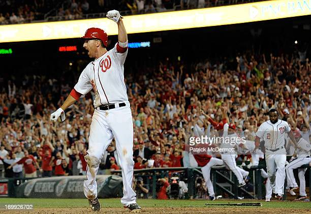 Adam LaRoche of the Washington Nationals celebrates after scoring the game winning run on a sacrifice fly by Stephen Lombardozzi in the ninth inning...