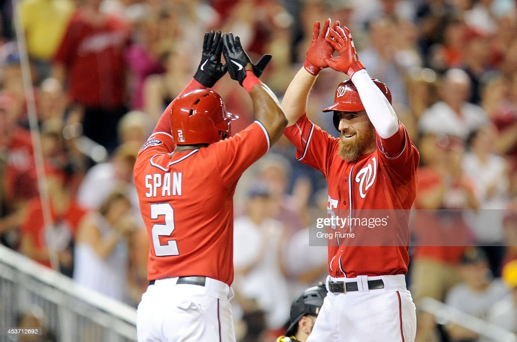 Adam LaRoche #25 of the Washington Nationals celebrates with <a gi-track='captionPersonalityLinkClicked' href=/galleries/search?phrase=Denard+Span&family=editorial&specificpeople=835844 ng-click='$event.stopPropagation()'>Denard Span</a> #2 after hitting a two-run home run in the eighth inning against the Pittsburgh Pirates at Nationals Park on August 16, 2014 in Washington, DC.