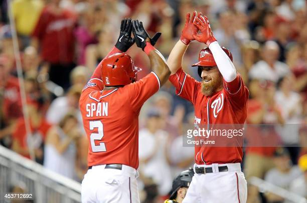 Adam LaRoche of the Washington Nationals celebrates with Denard Span after hitting a tworun home run in the eighth inning against the Pittsburgh...