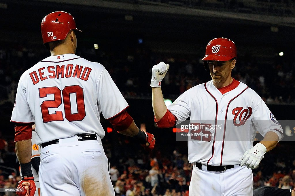 Adam LaRoche #25 of the Washington Nationals celebrates with Ian Desmond #20 after hitting a solo home run in the eighth inning during an interleague game against the Baltimore Orioles at Nationals Park on May 28, 2013 in Washington, DC.
